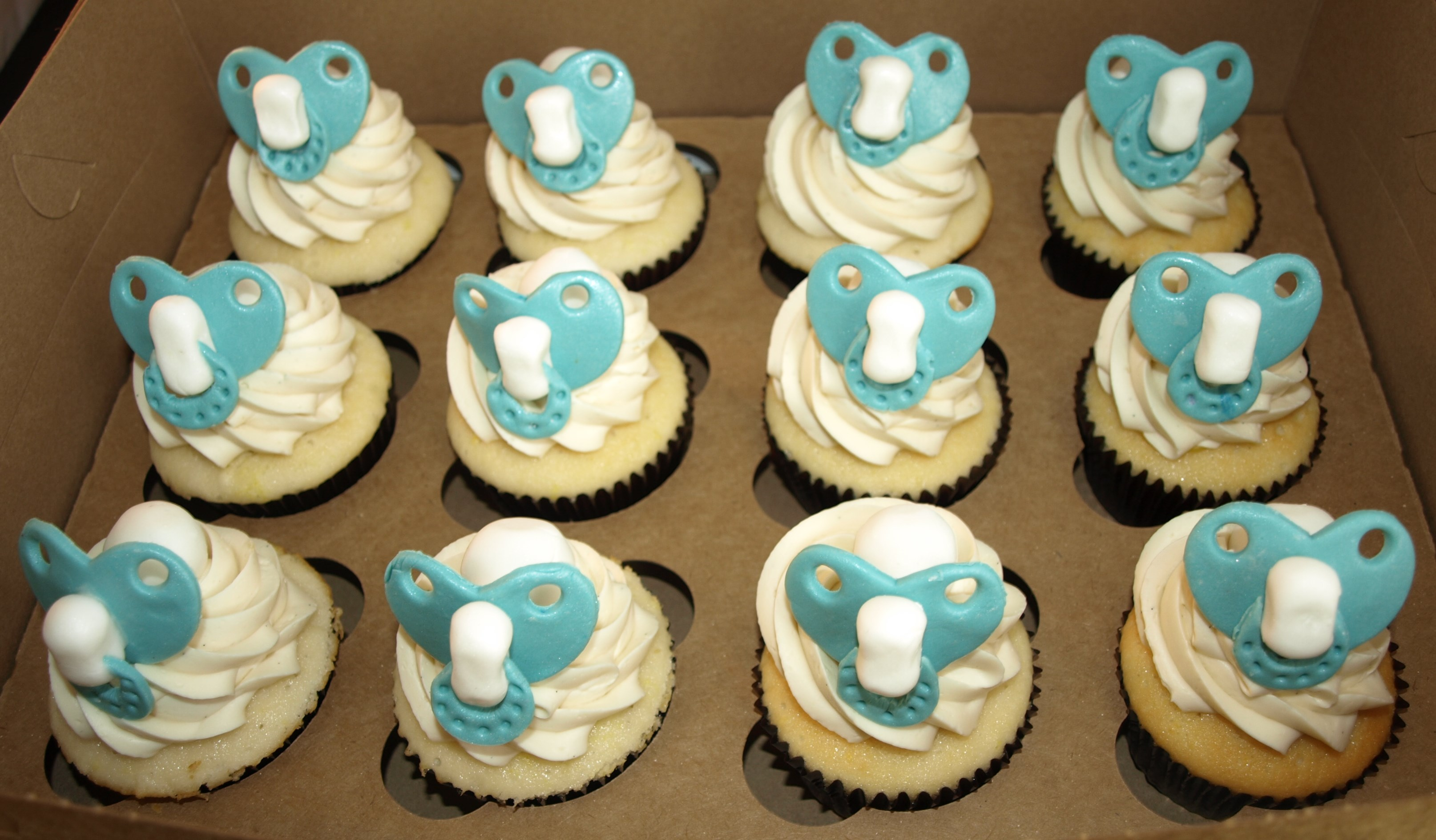 baby shower cupcakes aqua white cupcakes baby dummy cupcakes